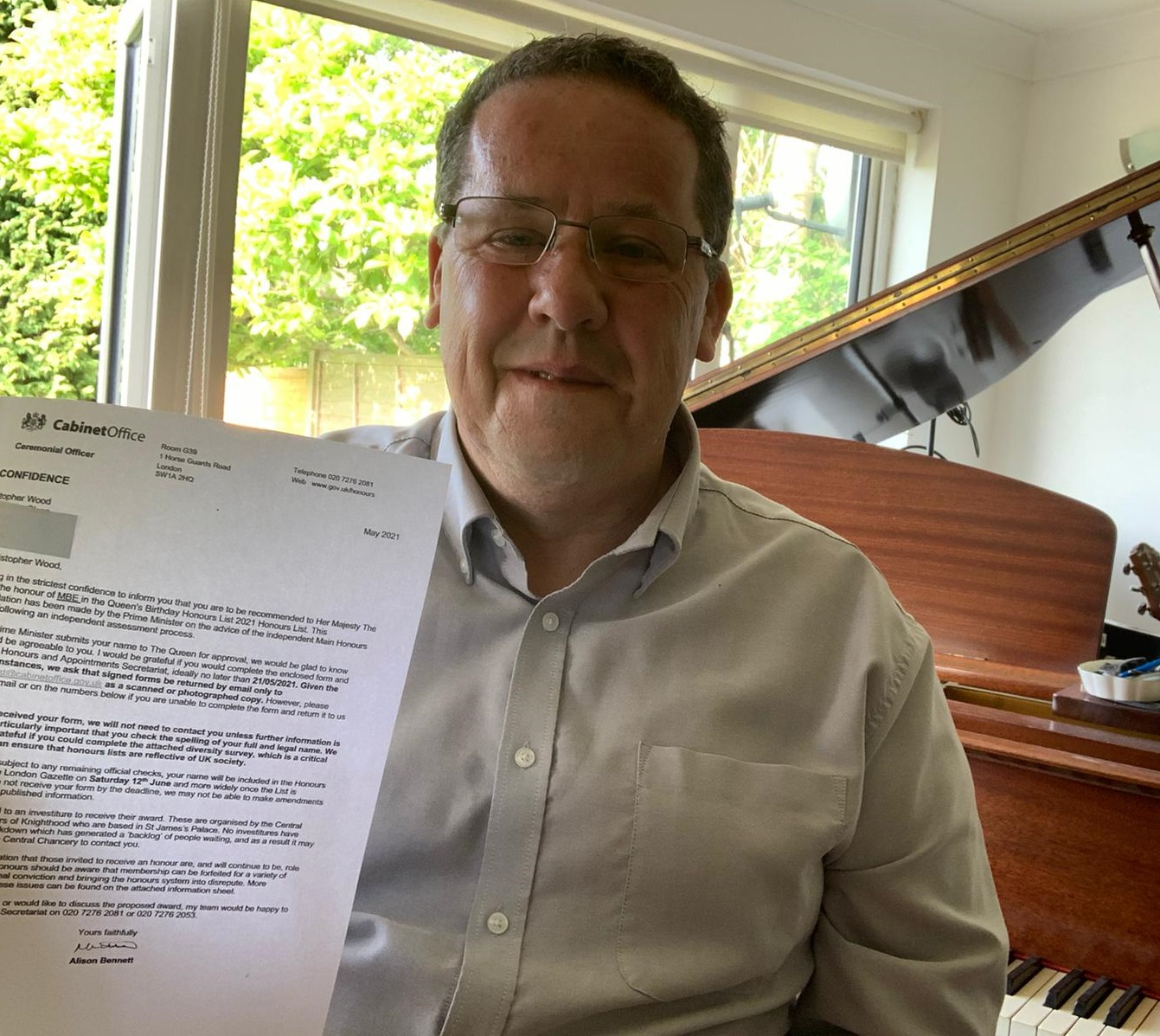 Chris Wood holds his letter from the Cabinet office up for the camera